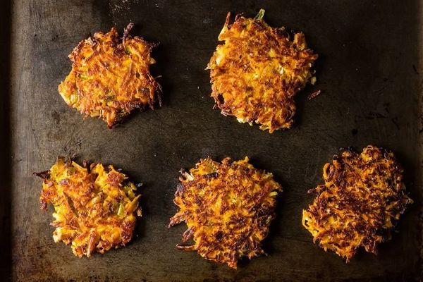 """<strong>Get the <a href=""""http://food52.com/recipes/7939-sweet-potato-parsnip-latkes-with-feta-and-leeks"""" target=""""_blank"""">Swee"""