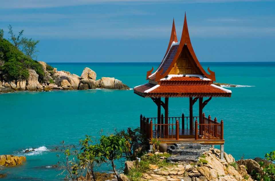 Thailand, Koh Samui, Choeng Mon Bay, samui peninsula resort, massage spa house with ornate roof overlooking the beach.