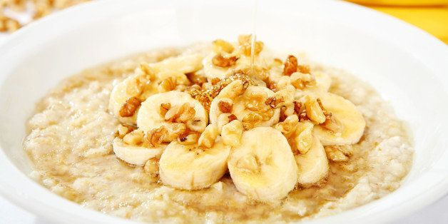 a bowl of oatmeal with bananas...