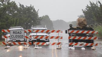 PAWLEYS ISLAND, SC - SEPTEMBER 14: Law enforcement close the bridge to Pawleys Island during Hurricane Florence on September 14, 2018 in Pawleys Island, South Carolina. Hurricane Florence is hitting along the North Carolina and South Carolina coastline bringing high winds and rain.  (Photo by Mark Wallheiser/Getty Images)