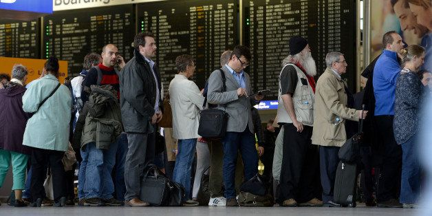 FRANKFURT AM MAIN, GERMANY - MARCH 12:  Passengers wait in a long line to rebook their cancelled flights at Frankfurt International Airport on March 12, 2013 in Frankfurt am Main, Germany. Europe's third busiest airport in Frankfurt closed at midday after recording about 12 centimeters of snow. More than 100 flights had already been cancelled and many others were delayed.  (Photo by Thomas Lohnes/Getty Images)