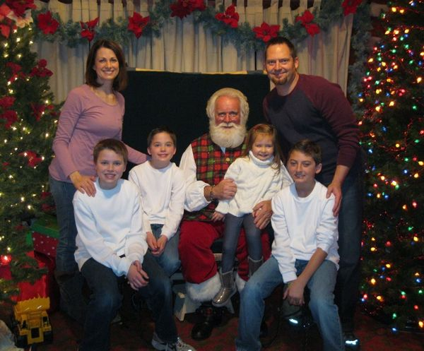 Ashley and Keith's family: Ashley, Brennan, Evan, Santa, Alexis, Keith (back) and Kyle