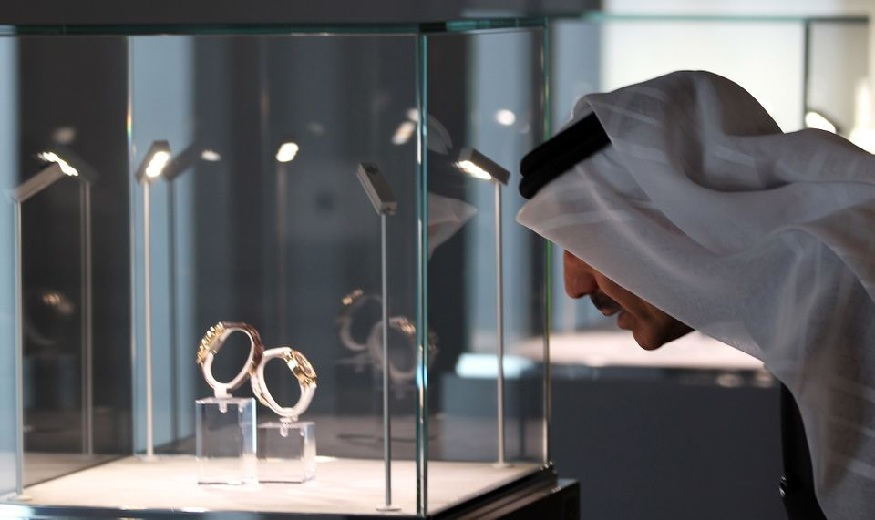 A man views a display cabinet at the opening of the Watch Art Grand Exhibition in Dubai, which shows around 400 exhibits from