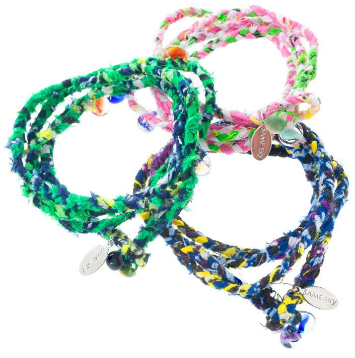 These bracelets are made of Rwandan fabric and decorated with hand-blown glass beads. Proceeds help provide employment to HIV