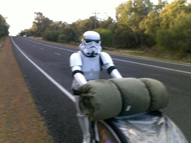 A stormtrooper walks the road to protect the Galactic Empire...and his sleeping bag.