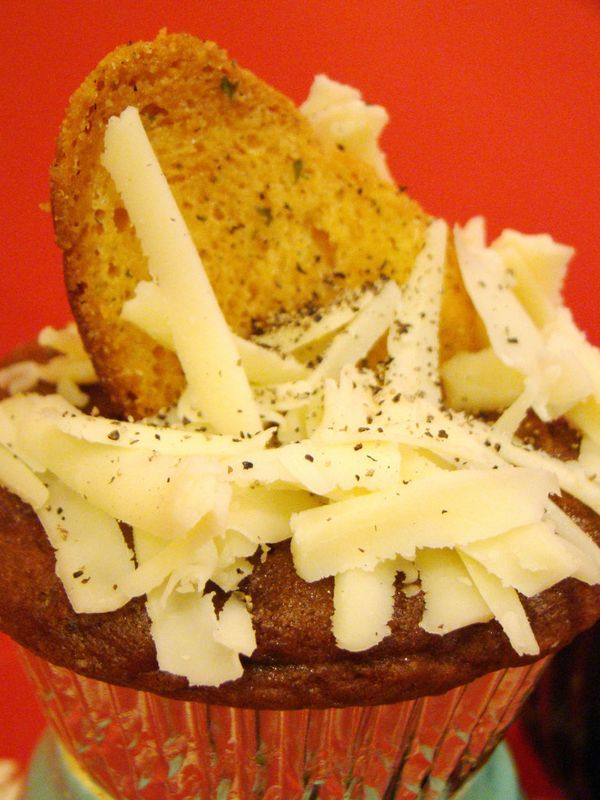 These cocoa chili cupcakes are topped with cheese and garlic bread. We can't even.