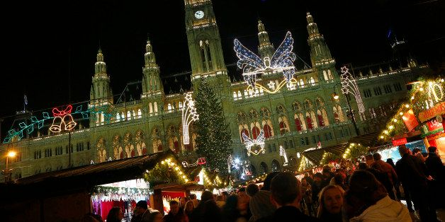 People gather at a Christmas market, in front of the 'Rathaus' townhall of in Vienna on December 1, 2012. AFP PHOTO / ALEXANDER KLEIN        (Photo credit should read ALEXANDER KLEIN/AFP/Getty Images)