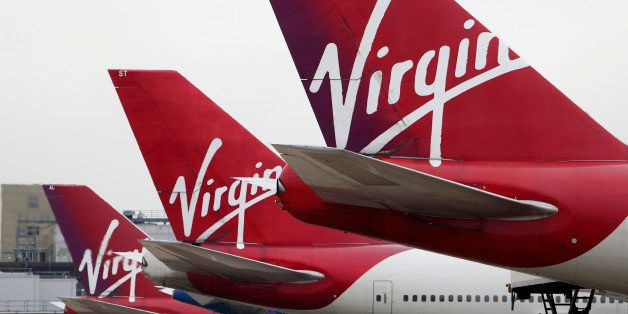 Logos sit on the tailfins of Virgin Atlantic aircraft at Gatwick airport in Crawley, U.K., on Thursday, Jan. 10, 2013. Gatwick, acquired by Global Infrastructure Partners Ltd. in 2009 after regulators sought a breakup of BAA Ltd., owner of the larger Heathrow hub, is 30 miles (48 kilometers) south of London and serves about 200 destinations, more than any other U.K. airport, according to flight schedule data provider OAG. Photographer: Chris Ratcliffe/Bloomberg via Getty Images