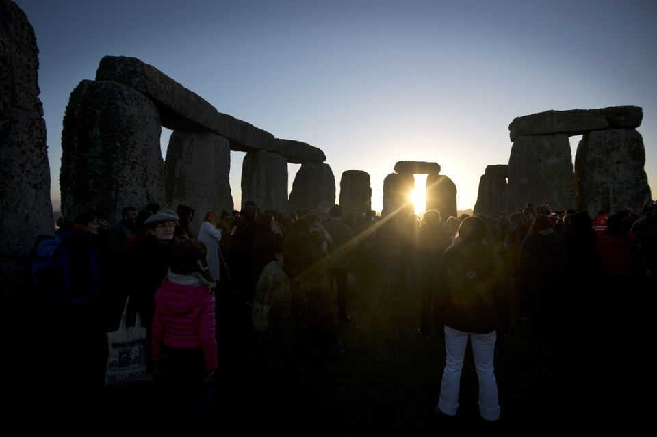 Revellers celebrate the pagan festival of 'Winter Solstice' at Stonehenge in Wiltshire in southern England on December 21, 20