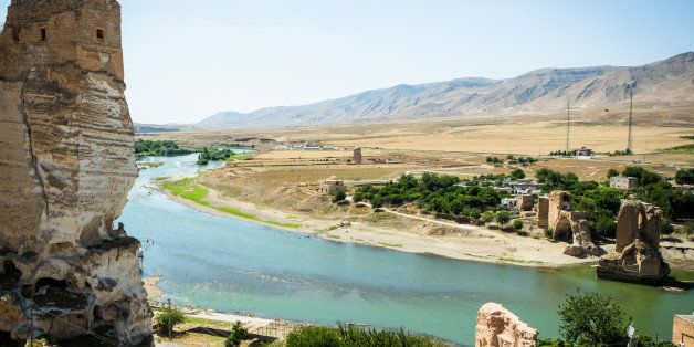 HASANKEYF, TURKEY - JUNE 07:  The panorama of Hasankeyf during a sunny day is pictured on June 07, 2013 in Hasankeyf, Turkey. Hasankeyf is an antique fortress located on the river Tigris in the province of Batman. (Photo by Christian Marquardt/Getty Images)
