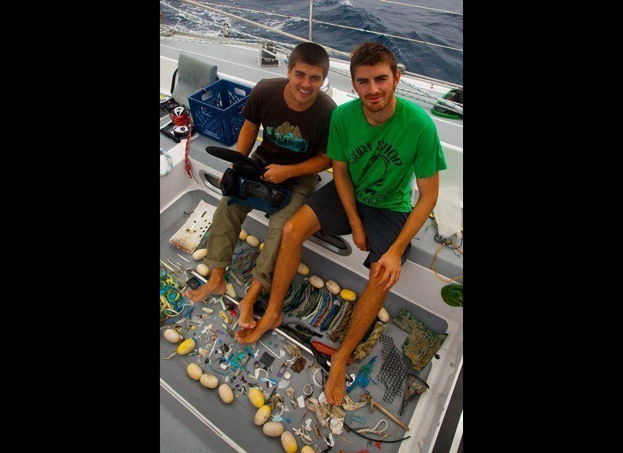 Tyler and Alex Mifflin with a small sample of some of the plastic items they pulled from the Pacific Ocean on the research ex