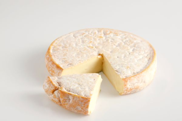 This soft, French, cow's milk cheese is pronounced <strong>reb-low-shawn</strong>. True Reblochon is banned in the US because