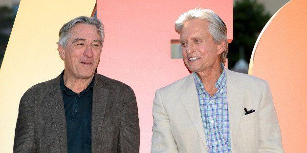 LAS VEGAS, NV - OCTOBER 18:  Cast members from CBS Films' 'Last Vegas' Robert De Niro (L) and Michael Douglas talk in front o