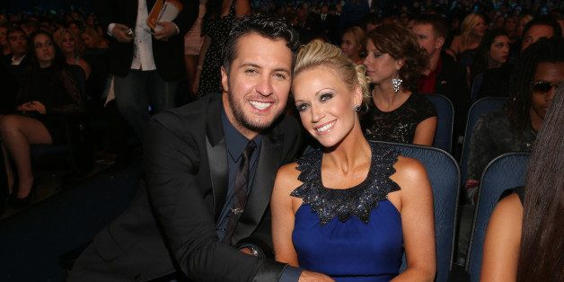 LOS ANGELES, CA - NOVEMBER 18: Singer Luke Bryan (L) and wife Caroline at the 40th American Music Awards held at Nokia Theatre L.A. Live on November 18, 2012 in Los Angeles, California.  (Photo by Christopher Polk/AMA2012/Getty Images for AMA)