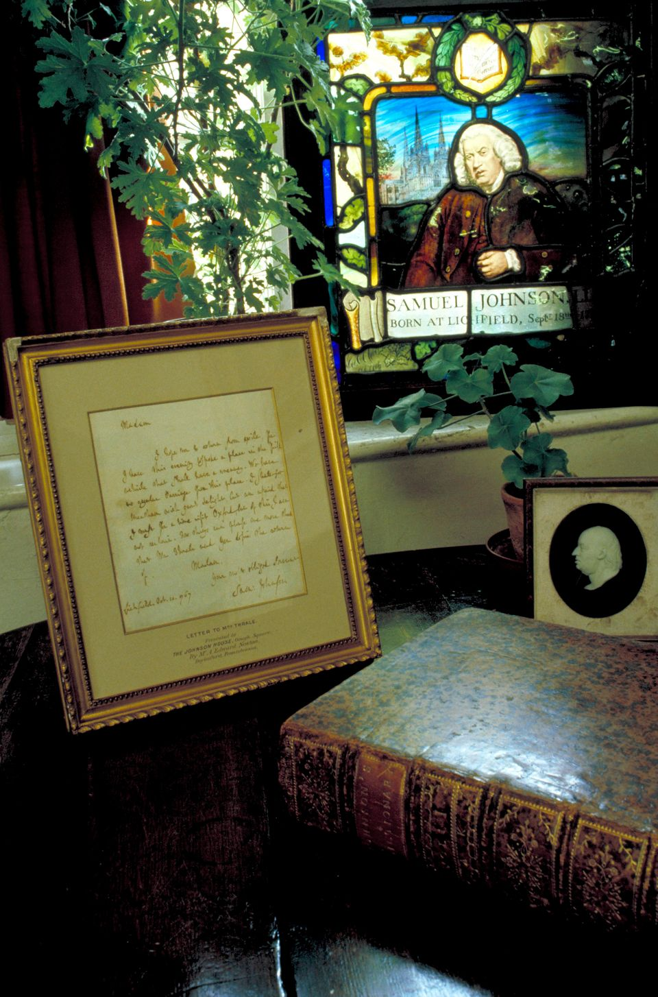 This March 17, 2009 photo released by VisitBritain shows shows a letter written by Samuel Johnson and a copy of the dictionar