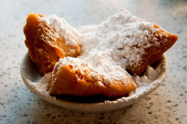 "They taste like <a href=""http://www.cafedumonde.com/"" target=""_blank"">pillowy clouds</a> that have been dusted in sugar."