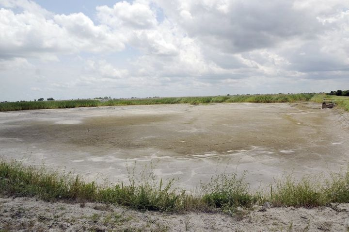 This photo, taken on June 23, 2014, shows the dried-up bed of an inactive coal ash pond at Duke Energy's Sutton pl