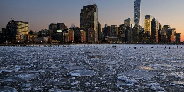 NEW YORK, NY - JANUARY 09:  Ice floes fill the Hudson River as the Lower Manhattan skyline is seen during sunset on January 9, 2014 in New York City. A recent cold spell, caused by a polar vortex descending from the Arctic, caused the floes to form in the Hudson.  (Photo by Afton Almaraz/Getty Images)