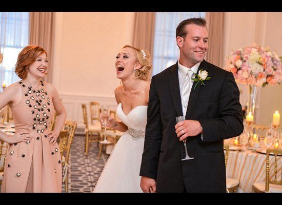 A bride seeing her wedding reception decor for the first time. Photo credit: John Arcara Photography