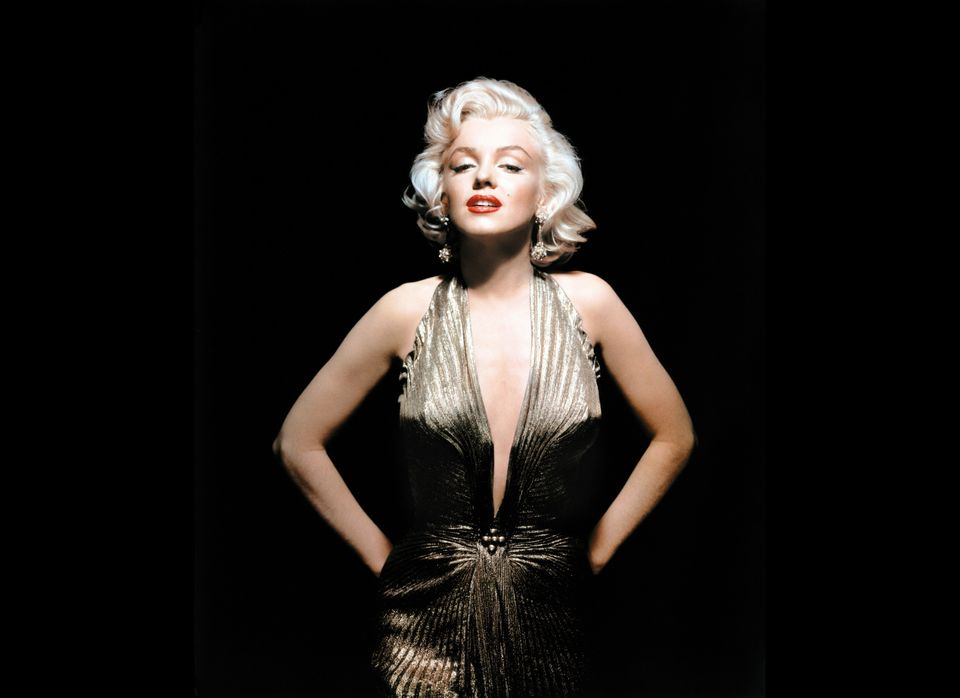 In this undated publicity photo courtesy Running Press, Marilyn Monroe is shown wearing a knife-pleated gold lamé gown made f