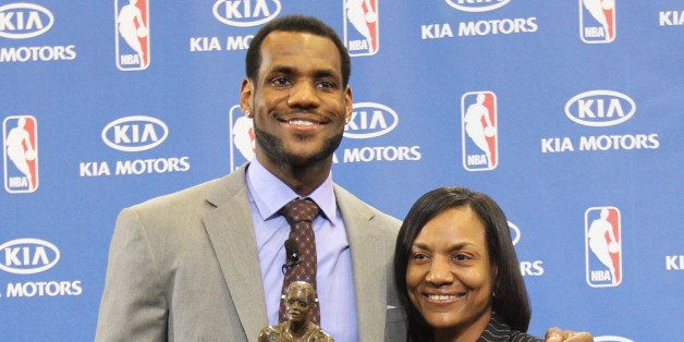 AKRON, OH - MAY 2: LeBron James of the Cleveland Cavaliers is joined by his mother Gloria James as he receives the Maurice Po