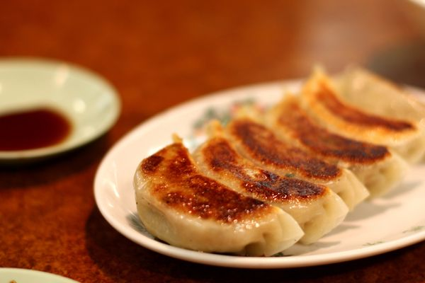 These Japanese dumplings are usually pan-fried and dipped in a mixture of rice vinegar, soy sauce and chili oil. A thin layer