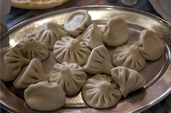 These Georgian dumplings traditionally contain a spiced meat but might also contain cheese and herbs. The flour-based dough i