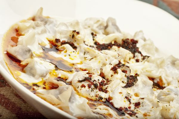 These dumplings from Central Asia are stuffed with beef or lamb and served with yogurt sauce. They're often seasoned with red