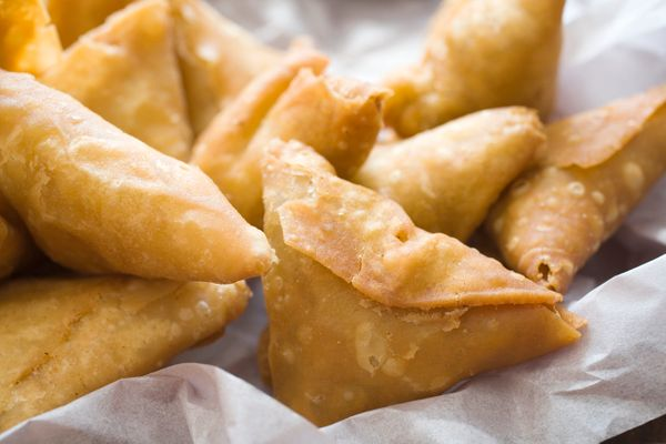 Samosa are a fried Indian pastries with a hard, crispy shell. They're usually filled with potatoes, peas and spices, and some