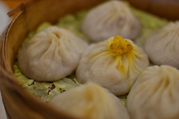 These steamed dumplings from Shanghai are known as soup dumplings for the injection of broth that they contain -- which keeps