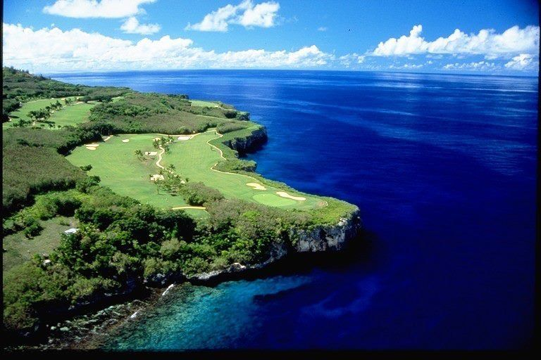 """Other early risers like to golf. Yes, this is one of Saipan's oceanside golf courses. That's right, we said one of. <a href="""""""
