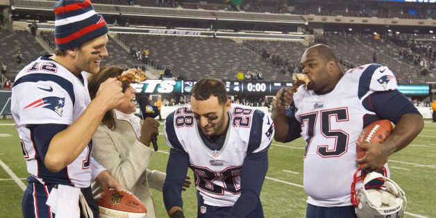 EAST RUTHERFORD, NJ - NOVEMBER 22: New England Patriots players, left to right, Tom Brady, Steve Gregory and Vince Wilfork join television broadcaster Michele Tafoya eating turkey legs after defeating the New York Jets 49-19 during a Thanksgiving Day game at Metlife Stadium on Thursday, Nov. 22, 2012. (Photo by Matthew J. Lee/The Boston Globe via Getty Images)