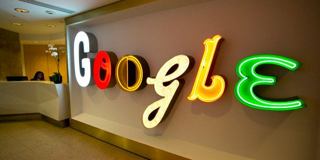 In this Monday, Oct. 28, 2013 photo, Google's trademark name lights up the lobby to the company's offices in New York. (AP Photo/Mark Lennihan)