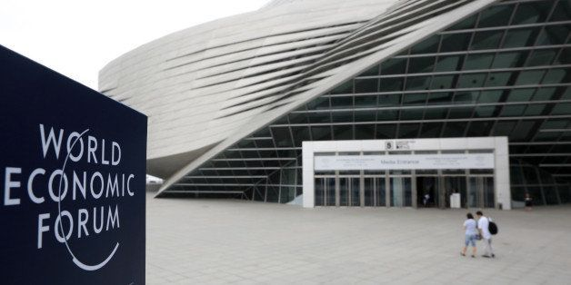 The World Economic Forum logo is displayed on a sign outside the Dalian International Conference Center in Dalian, China, on