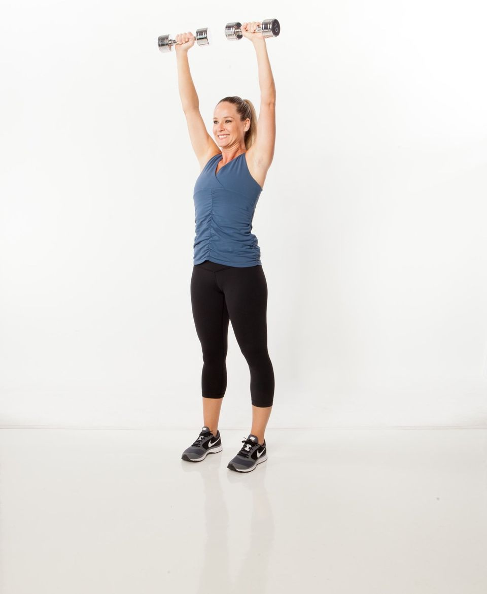 <strong>Sets: 3 Reps: 10</strong>  Stand with feet slightly wider than hip-width apart, holding dumbbells. Engage abs and ext