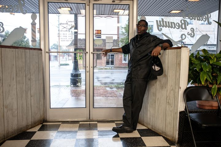 Jeano Farrow stands at the front door of Jeano's Beauty & Barber in downtown Kinston, North Carolina. The shop stayed ope