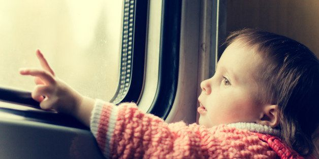 a boy rides on a train and...