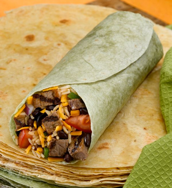 The burrito is already a perfect food, and the tortilla is its perfect vessel. If you ever meet a burrito in a green or red ""