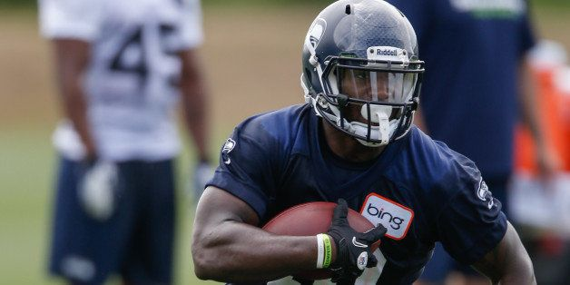 RENTON, WA - MAY 11:  Running back Derrick Coleman #40 of the Seattle Seahawks rushes during Rookie Camp at the Virginia Mason Athletic Center on May 11, 2013 in Renton, Washington.  (Photo by Otto Greule Jr/Getty Images)