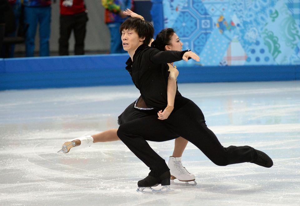 China's Qing Pang and China's Tong Jian perform in the Figure Skating Pairs Short Program at the Iceberg Skating Palace durin