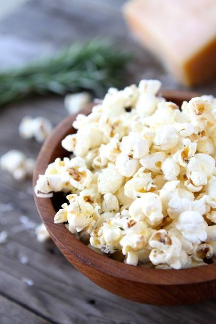 "<strong>Get the <a href=""http://www.twopeasandtheirpod.com/garlic-rosemary-parmesan-popcorn/"" target=""_blank"">Garlic Rosemary"