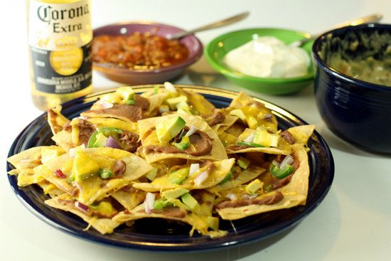 "<strong>Get the <a href=""http://www.macheesmo.com/2009/02/near-perfect-nachos/"" target=""_blank"">Near Perfect Nachos</a> recip"