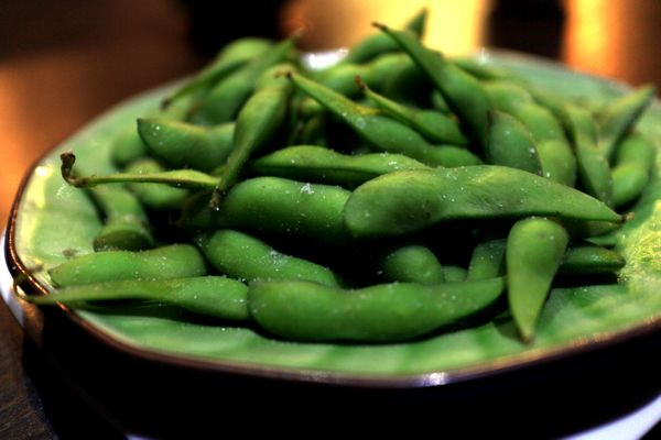According to both of our experts, edamame is a perfect low-calorie, high-protein appetizer to start with, especially if you r