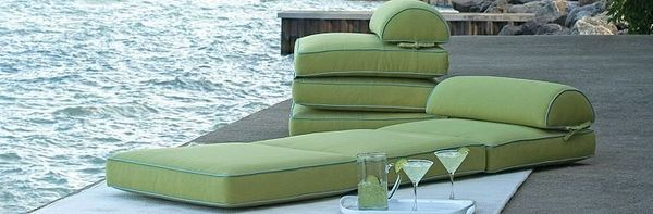 These cushions might be intended for poolside, but they'd work on a balcony, roof or covering a makeshift bench.  The <a href