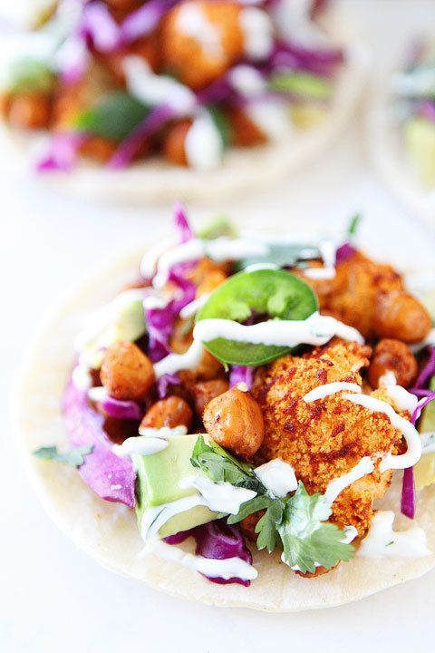"""<strong>Get the <a href=""""http://www.twopeasandtheirpod.com/roasted-cauliflower-and-chickpea-tacos/"""" target=""""_blank"""">Roasted C"""