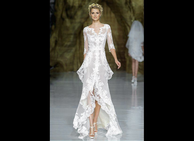 "With flattering three-quarter-length sleeves and a fashionable high-low hem, this flowy lace gown by <a href=""http://www"