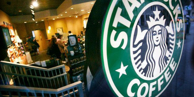 A Starbucks coffee shop begins to slow down early Tuesday evening just before closing it's doors early, Feb. 26, 2008, in Seattle. Starbucks, the world's largest gourmet coffee retailer, shut its doors for three-hour nationwide training sessions Tuesday evening. (AP Photo/Elaine Thompson)