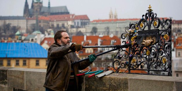 PRAGUE, CZECH REPUBLIC - MARCH 18:  Roman Kotrc from Charles Bridge Artists Association removed love padlocks from Charles Bridge, on March 18, 2014 in Prague, Czech Republic. Charles Bridge Artsist Association believe that placing the love padlocks on the historic sight is an act of vandalism and remove approximately 40kg of padlocks each fortnight. The act of fixing a padlock to a historic sight is a growing phenomenon in cities across Europe as couples leave them as a symbol of their love.  (Photo by Matej Divizna/Getty Images)