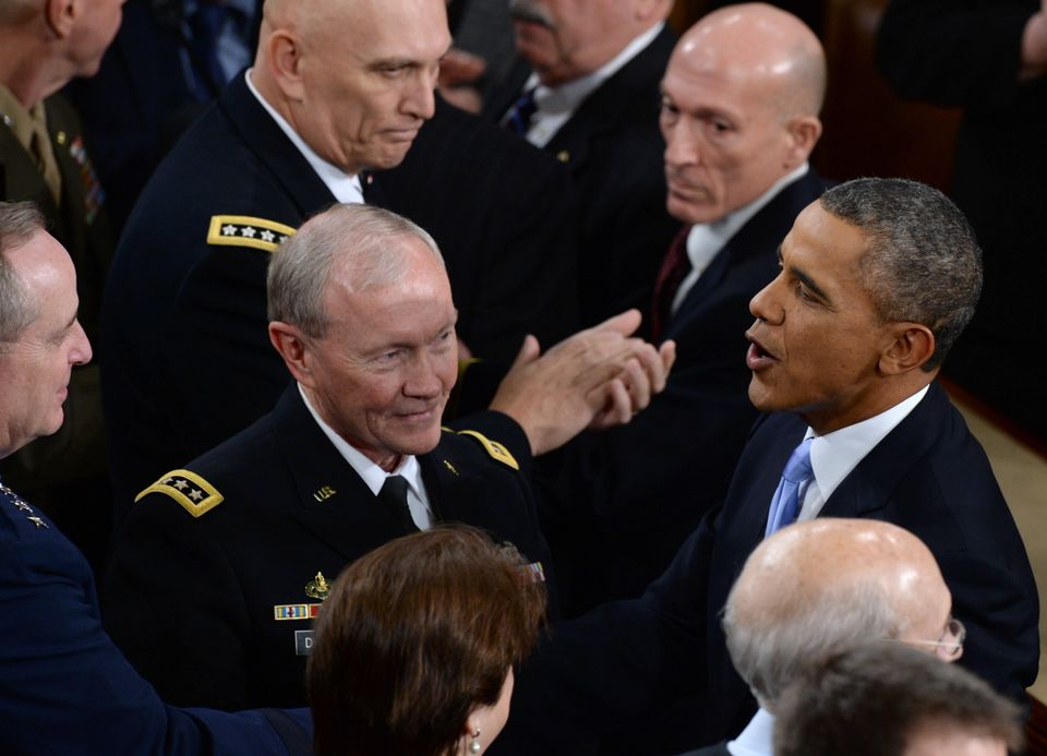 US President Barack Obama greets members of the military top brass as he arrives to deliver his State of the Union address be