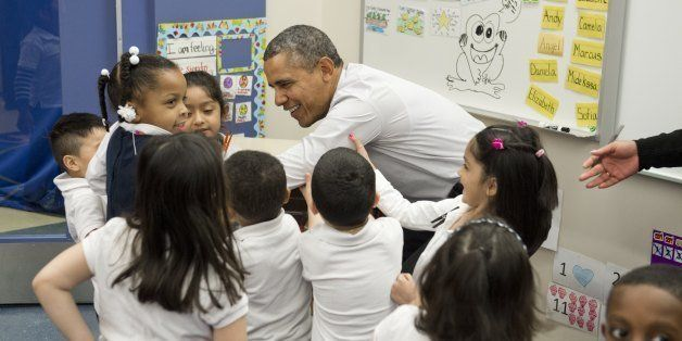 US President Barack Obama is helped up from the floor by children as he tours a Pre-K classroom at Powell Elementary School prior to speaking on the Fiscal Year 2015 budget in Washington, DC, March 4, 2014. The White House projected a steady fall in the US deficit over the next decade while the economy grows moderately, as it released its budget for the 2015 fiscal year on Tuesday. The budget foresees the American economy growing by 3.1 percent this year and by 3.4 percent the next, with inflation remaining under control, rising to only 2.0 percent in 2015.AFP PHOTO / Saul LOEB        (Photo credit should read SAUL LOEB/AFP/Getty Images)